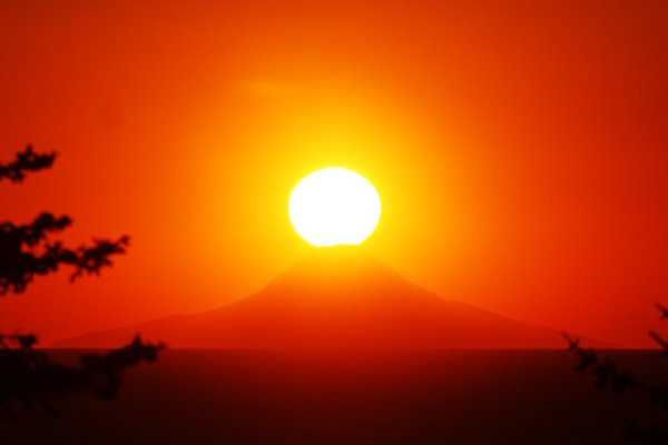 The sun sets atop Augustine Volcano.