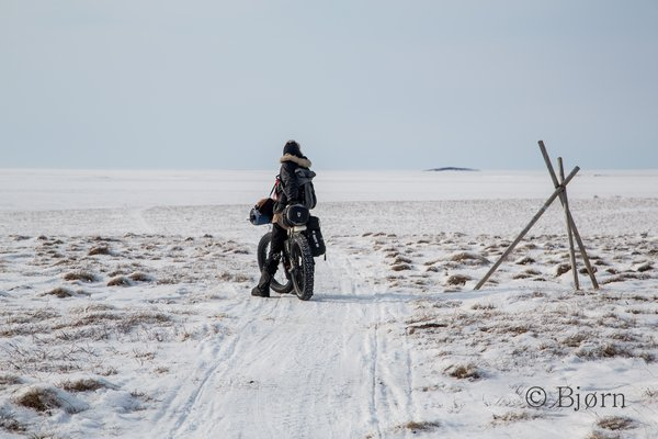 Kim and Bjørn ride the final stretch into Kotzebue after 36 days out.