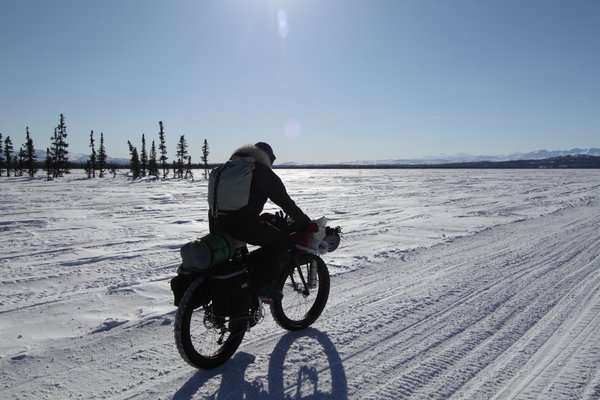 Biking toward the Alaska Range. This is one of the places where the proposed natural gas pipeline, to supply power to the mine, would cross the historic Iditarod Trail.