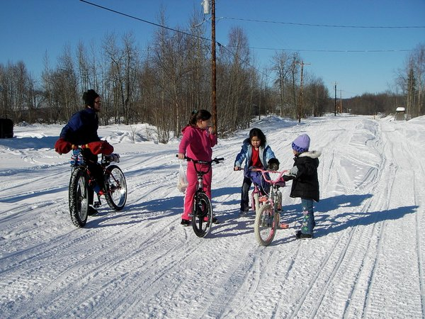 After being in Sleetmute for a few hours, local kids began riding their bikes on the hard packed snow trails too. We organized an impromptu bike race down the main road.