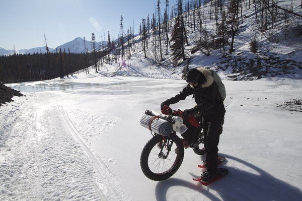 Overflow ice can be very slippery. Crampons are needed to cross these short sections of the Iditarod Trail.