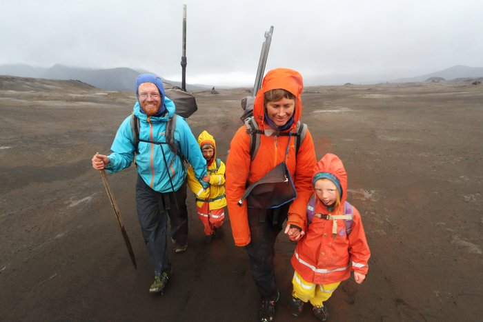 Family trekking in volcano