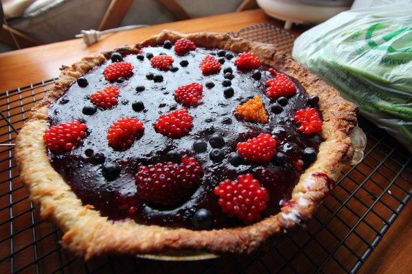 Salmonberries and blueberries make a fresh berry pie