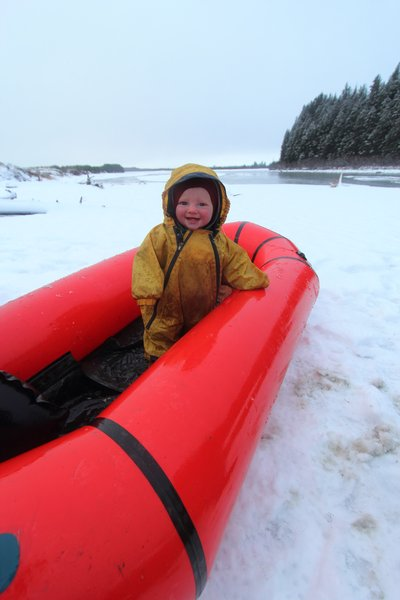 Hanging out in the packraft-crib, Lituya was very cheery despite the cold sleety day.