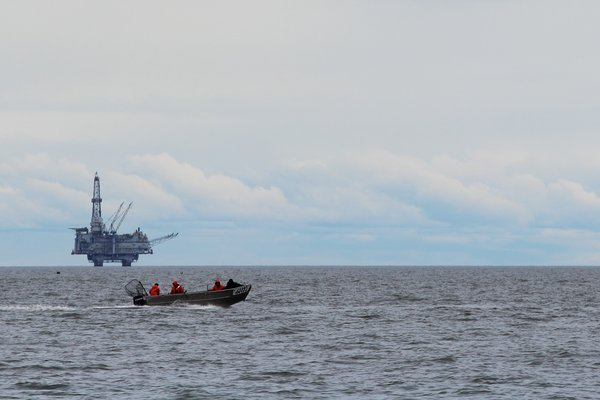 A set net fishing skiff heads off to cross Cook Inlet.
