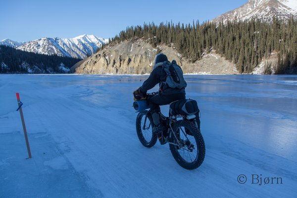 Kim cycles down the headwaters of the Kuskokwim River.
