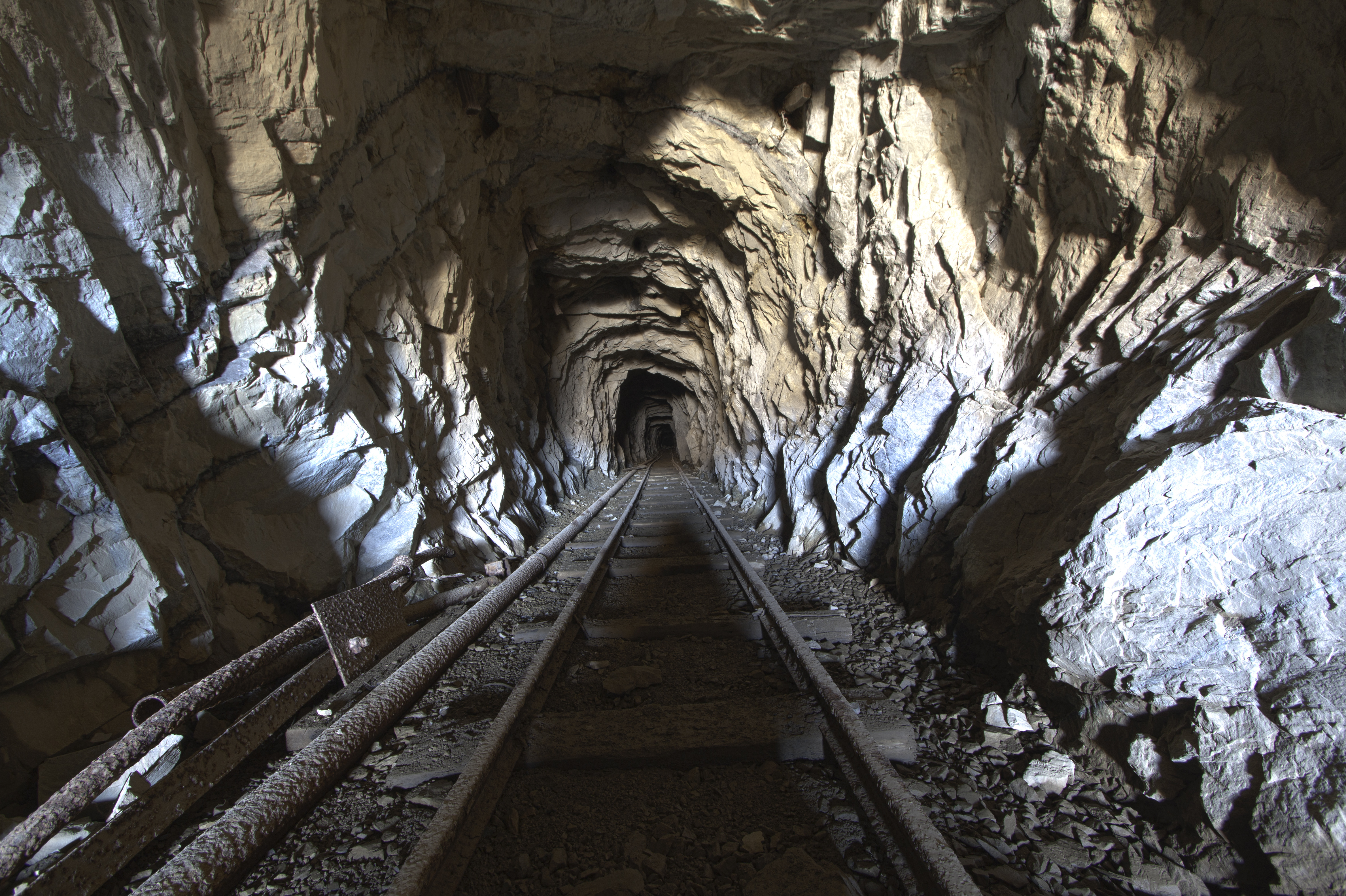 shaft mining Shaft mining is a form of underground mining using shafts driven vertically from  the top down into the earth to access ore or minerals shaft.
