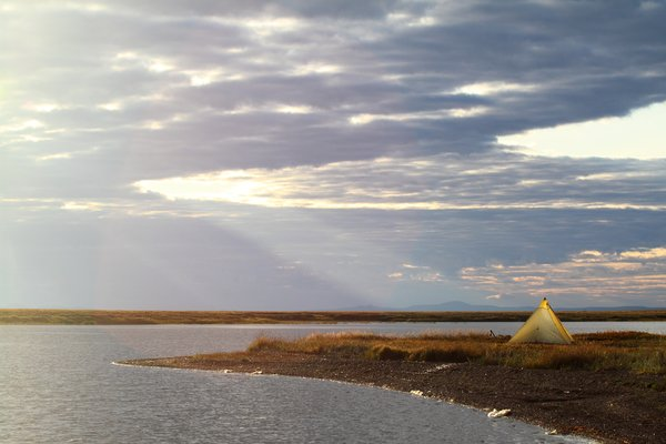 On a spit of land poking into an Arctic lagoon, our shelter glows.
