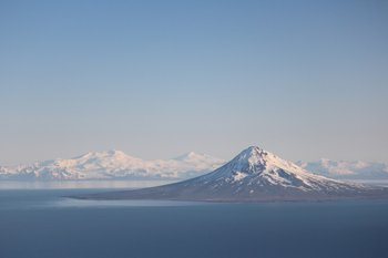 This active volcano forms an island in the western part of Cook Inlet.