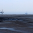 Oil rigs and mudflats