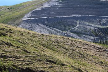 By planting grass and terracing slopes, reclamation crews are attempting to reduce erosion in the closed Poker Flats coal mine.