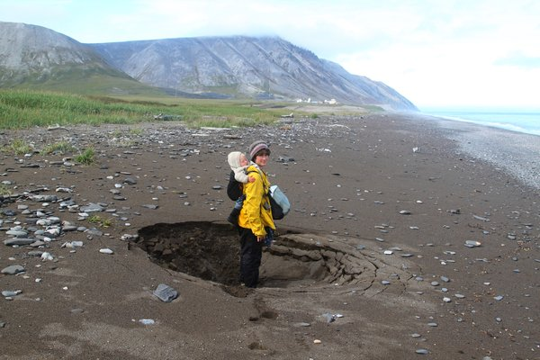This sinkhole in a beach on the Chukchi sea is evidence that permafrost deep below is melting.