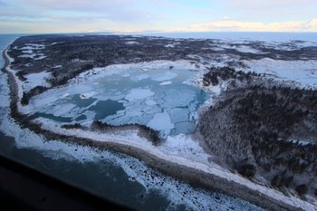Once this was the Sitkagi Bluffs, but now the ice is melting and lakes and lagoons replace the towering ice.