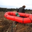 Trying out the prototype packraft-unicycle-cart