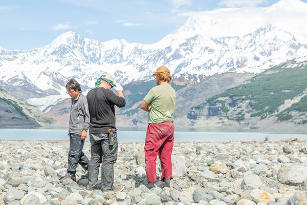 Dr. Bretwood Higman and two students discuss where to dig a trench. All of the material in the foreground was deposited from the landslide generated tsunami, nearly five miles away. Much of this area was covered in sediment in excess of several feet.