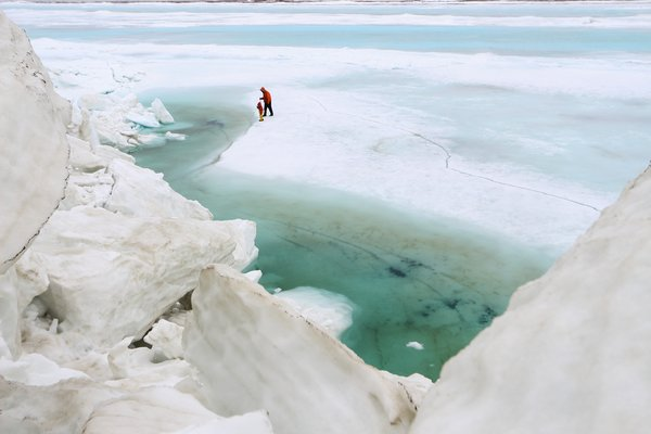 Turquoise pools formed around the ice piles, reducing the albedo and speeding up the melt