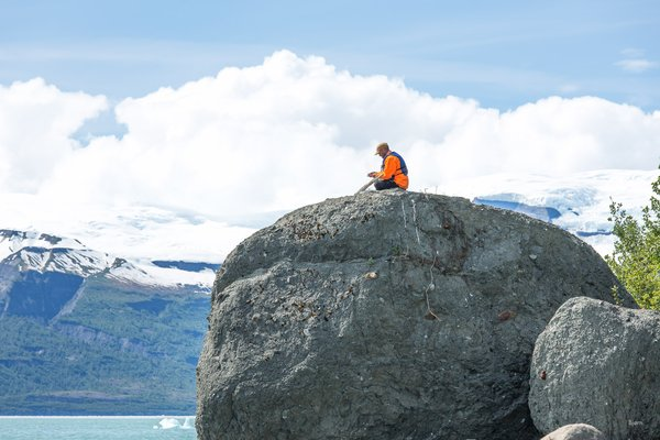 Andrew Mattox affixes a 'control point' atop of a glacial erratic in Icy Bay, Alaska. The control points, in this instance, were five gallon bucket lids with targets painted on them. The targets are useful for aerial surveys of Taan Fjord, which experienced a massive landslide and tsunami, in October 2015.