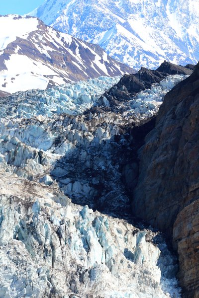 This glacier was once a feeder into the Malaspina Glacier, but it separated from there sometime mid-20th century, and has since retreated until its terminus is a mere 11 miles from the 18000 foot summit of Mt. St. Elias.