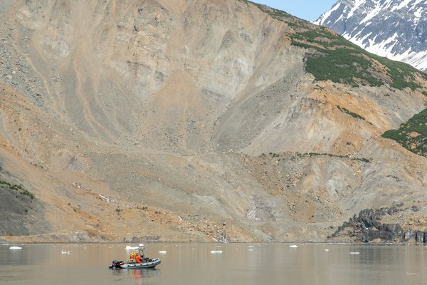 The National Park Service skiff under the landslide gives some perspective to the size of the slide.